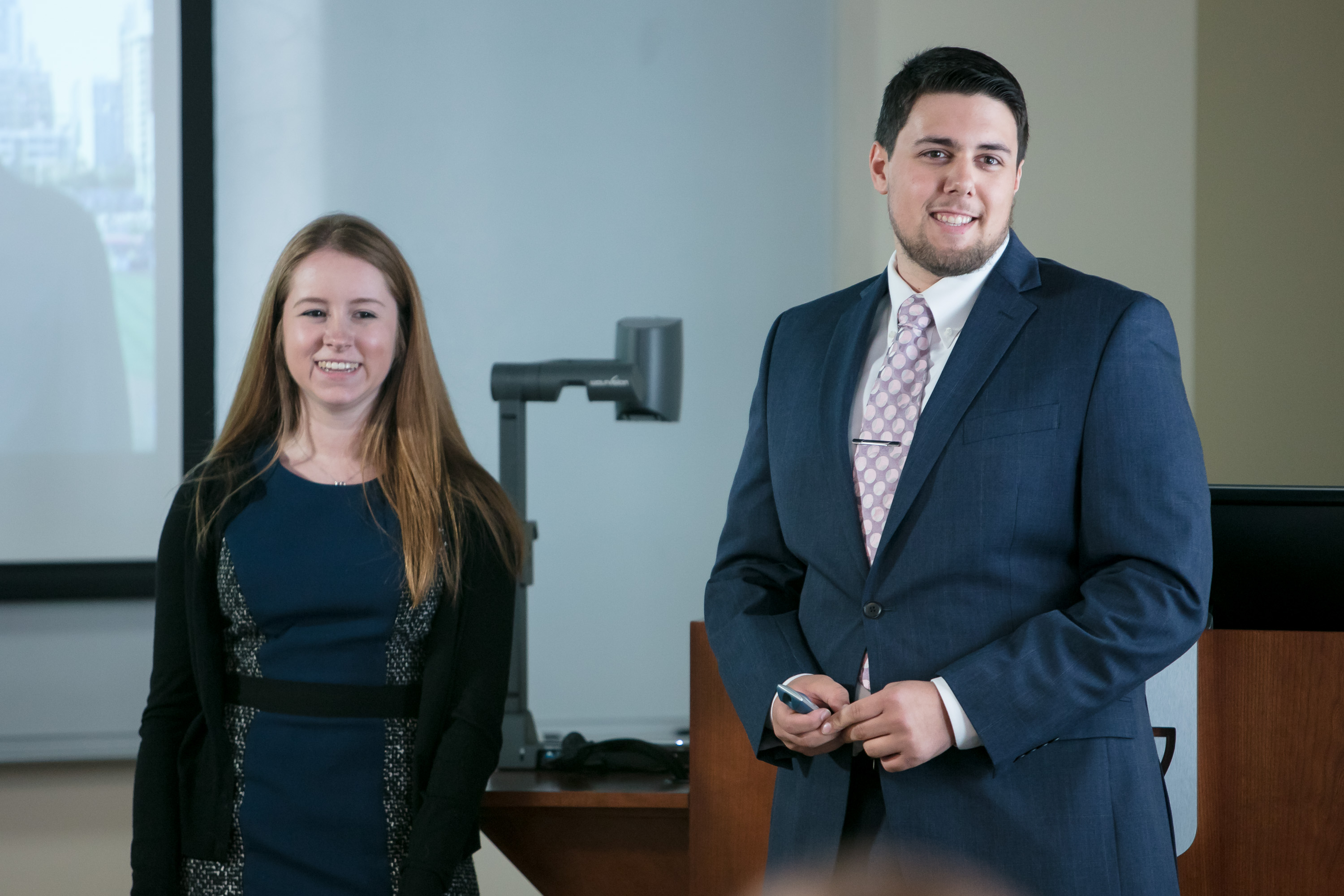PRAD students Melissa Bellew, left, and Ben Gartland present campaign plan ideas about sustainability to FOX Sports, 21st Century Fox and Major League Baseball executives. (DePaul University/Jeff Carrion)