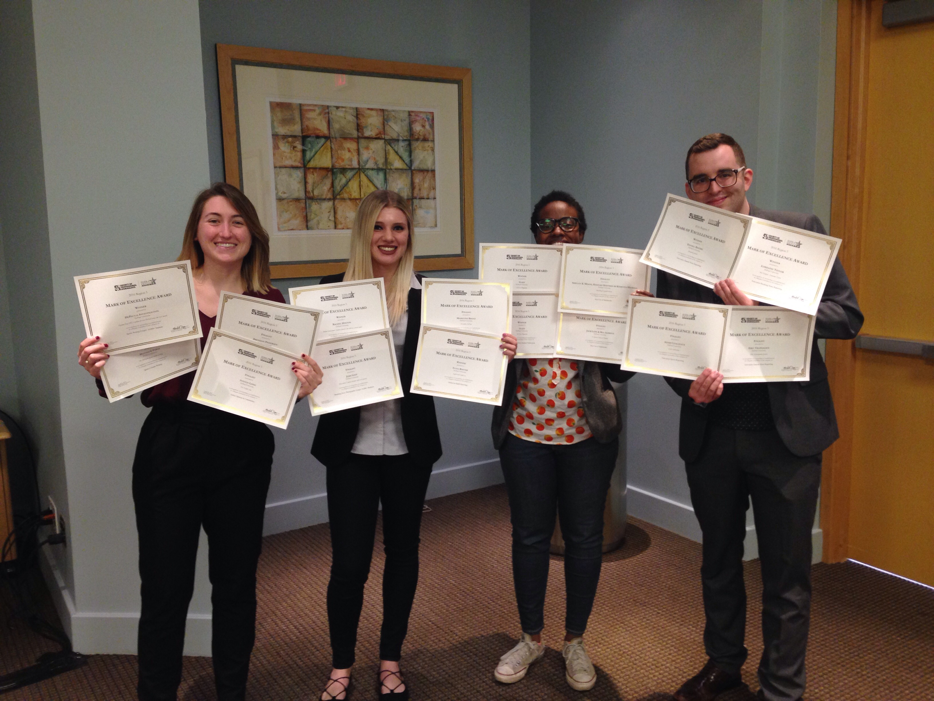DePaul SPJ/ONA Chapter officers pose with certificates for the 16 awards won by DePaul student journalists at last weekend's SPJ Region 5 conference in Indianapolis. From left, Danielle Church, Ally Pruitt, Rachel Hinton and Kyle Woosley.