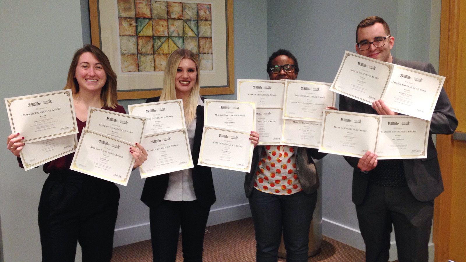 SPJ/ONA chapter posing with awards